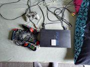 Playstation 2 mit Spielen und
