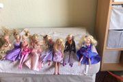 8 Barbie Puppen