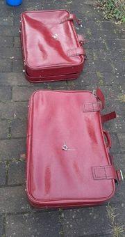 2 rote Leder Reisekoffer