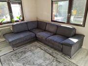 L Couch mit Schlaffunktion und