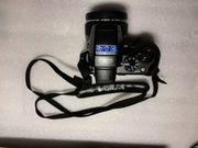 Olympus SP-565UZ Digitalkamera 10 0