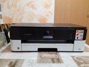 Defekter Drucker mit neuen und
