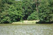 Garten mit Seeblick an Wassersportler
