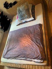 Bett aus Rattan