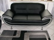 Zweisitzer Sofa Lederlook Soft schwarz