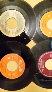 4 alte Kult-Vinyl-Singles