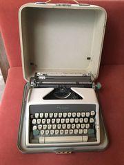 Koffer-Schreibmaschine Olympia