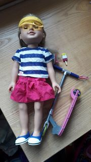 Puppe mit Zubehör