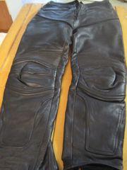 Motorradbekleidung für Frau und Mann