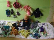 handgestrickte Puppenbekleidung