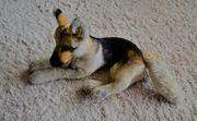 Hund von Steiff liegend