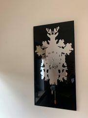 Glas-Wanduhr mit Kuckucksuhr-Motiv schwarz