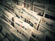 Gemeinsam Zeitungen verteilen