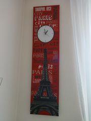 stylische Wanduhr Eifelturm rot schwarz