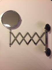 Spiegel mit Teleskop