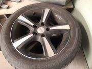 3 Dunlop Reifen mit Alufelgen