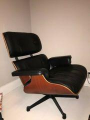 VITRA Lounge Chair mit Fußhocker