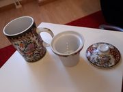 Teetasse mit Teesieb und Deckel