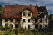 Renovierungsbedürftiges Mehrfamilienhaus