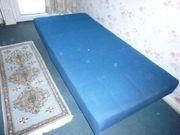 blaues Polsterbett mit Bettkasten 2m