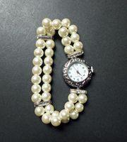 Damen - Armbanduhr mit Glasperlen-Armband