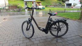Damen und Herren E Bike