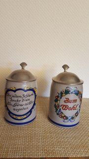 2 originelle Bierkrüge mit Zinndeckel