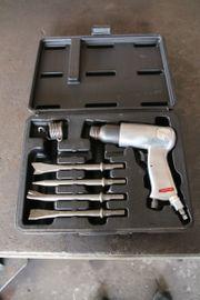Presslufthammer mit Meissel im Koffer