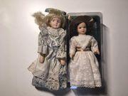 Zwei Puppen aus Porzellan neu