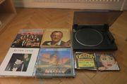 Plattenspieler und alte Schallplatten