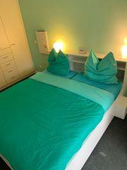 Bett mit viel Stauraum inkl