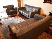 Couchgarnitur dreiteilig mit grauem Lederbezug