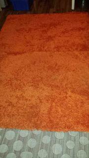 Suche einen orange farbenen Langfloorteppich