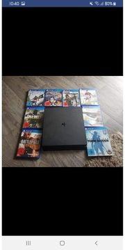 PS4 Slim mit 8 Spielen