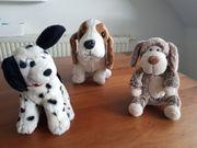 3 niedliche Stoffhunde