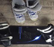 Snowboard von Kemper mit Schuhen