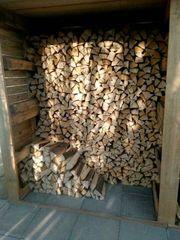 Brennholz im handlichen Raschelsack Fichte