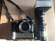 Nikon FE mit Zubehör komplett