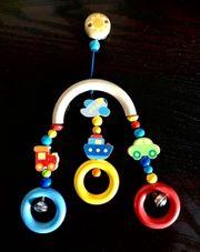 Maxicosi- oder Kinderwagenspielzeug