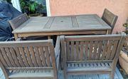 4 Gartenstühle und 1 Tisch