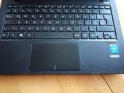 Asus X200m Notebook und Logitech