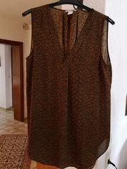 Kombinierfreudige Long-Bluse ohne Ärmel Gr