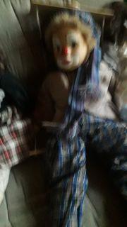 Verschiedene Deko Prozellanpuppen und Marionette