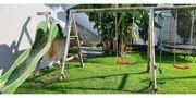 Gartenschauckel mit Rutsche für Kinder