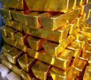 Goldpulver und Goldbarren