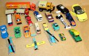 20 verschiedene Spielzeugautos und 3