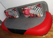 Couch plus 2 Kissen zum