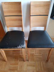 Holzstühle mit Lederbezug
