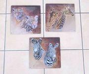 3 Blechschilder mit Giraffen Leoparden