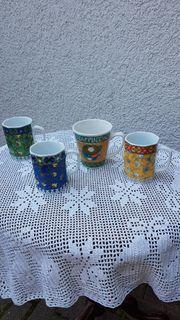 4er-Set Tassen mit besonderem Dekor